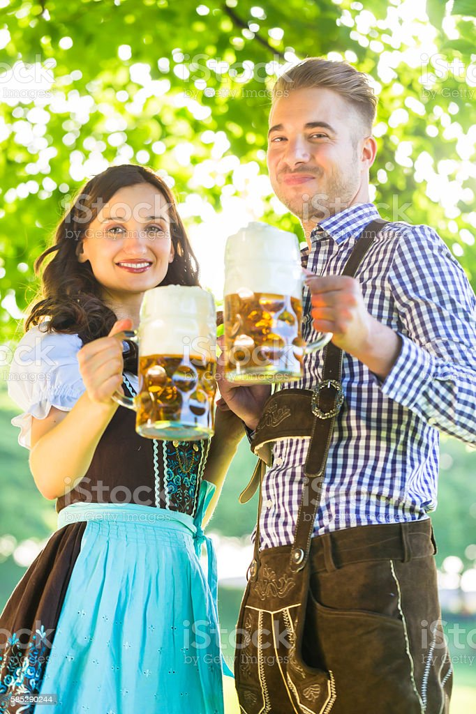 German couple in Tracht drinking beer stock photo
