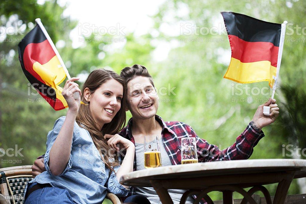 German couple waving flags, Bundesflagge stock photo