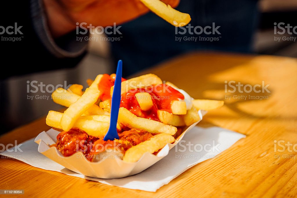 German Currywurst with french fries stock photo