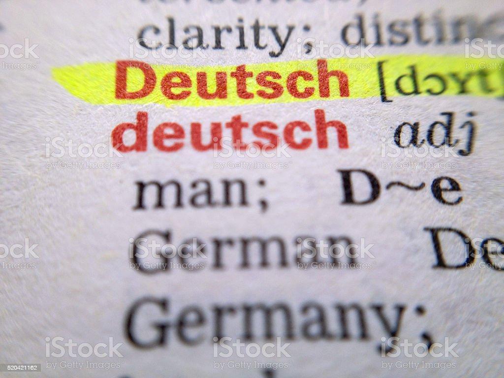 German - Deutsch in dictionary stock photo
