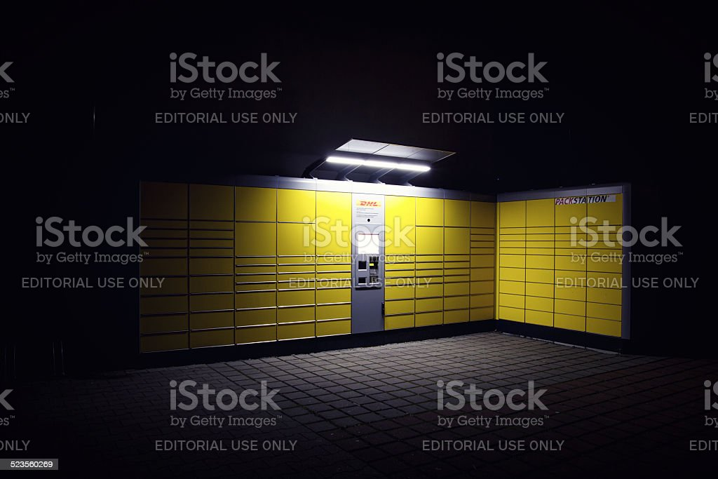 German DHL Packstation at night. stock photo