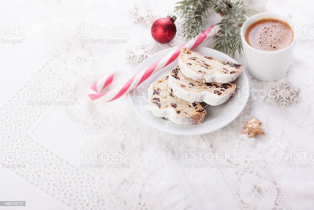 German dresdner stollen cake with candied oranges and coffee stock photo