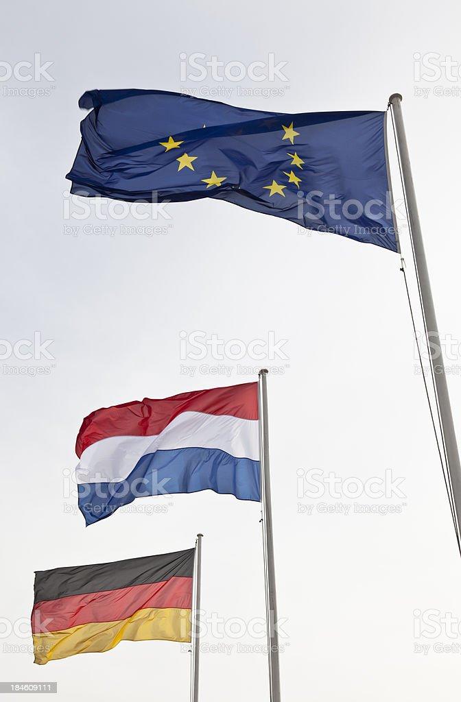 German, Dutch and European Union Flags royalty-free stock photo