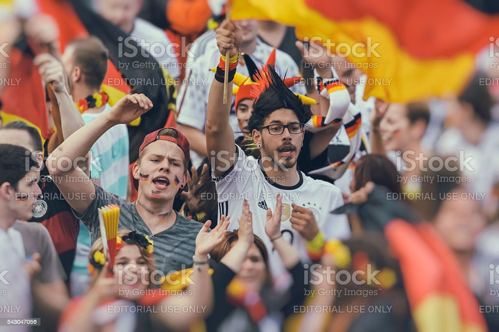 German fan supporters cheering celebrating soccer team stock photo