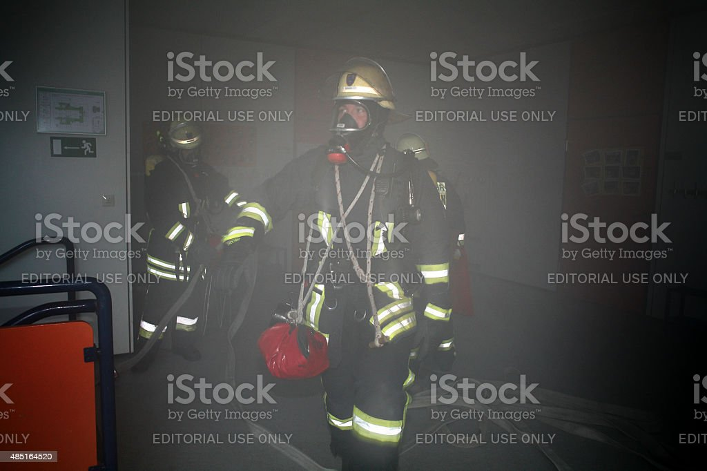 German firefighters with respiratory devices during an exercise stock photo