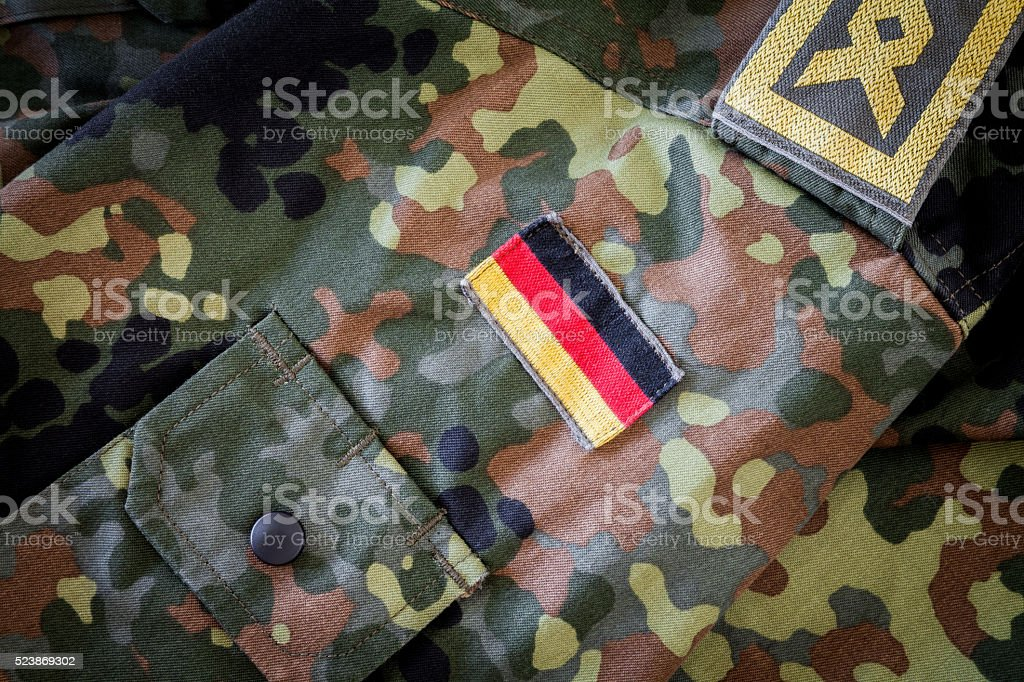german flag and chief petty officer badge on military jacket stock photo