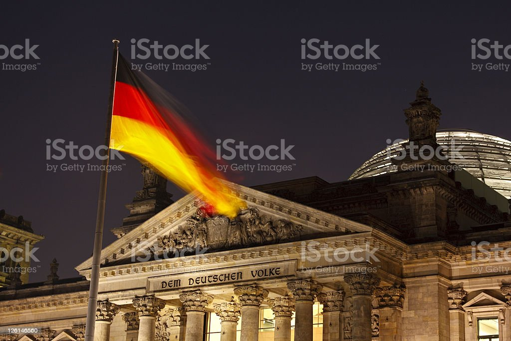 German Flag And Reichstag At Night royalty-free stock photo