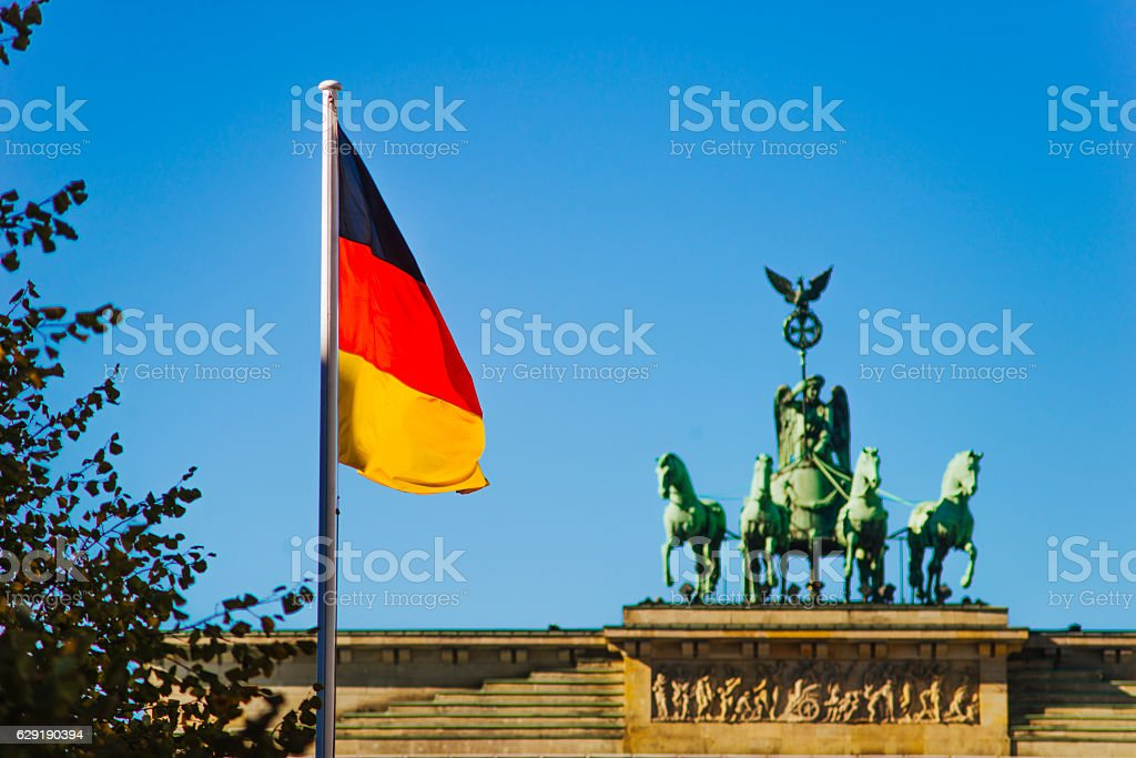 German flag at Brandenburg Gate stock photo