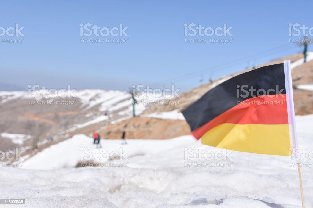 German flag in the snow stock photo
