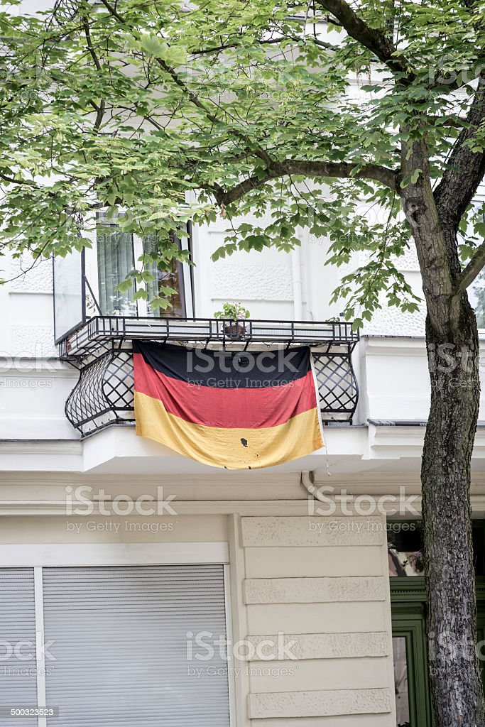 german flag on a balcony, berlin germany stock photo