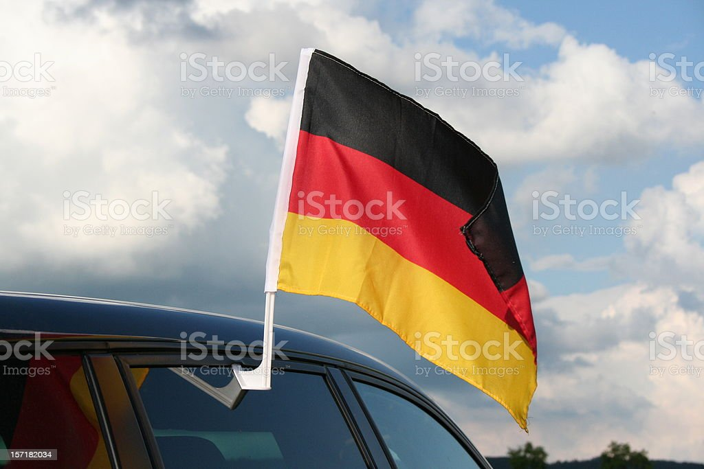 german flag on the top of a car stock photo