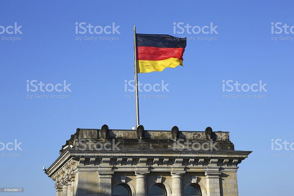 German flag waving on Bundestag in Berlin royalty-free stock photo