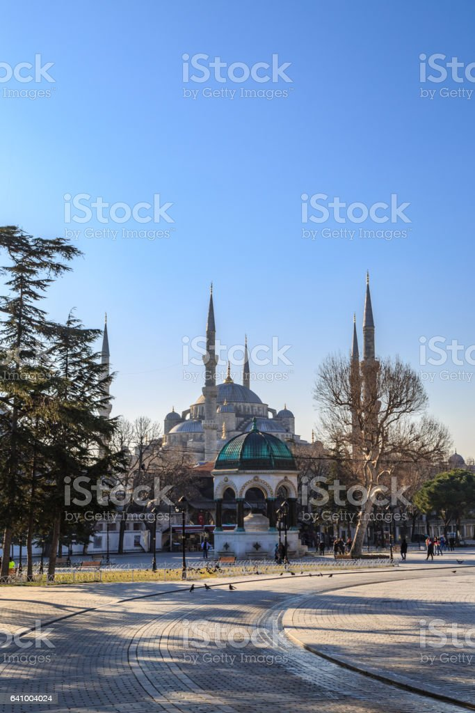 German fountain in sultanahmet square with blue mosque background. stock photo
