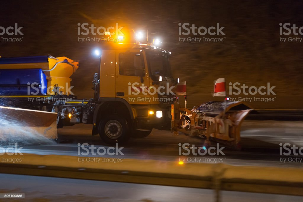 german highway snow plow at night stock photo