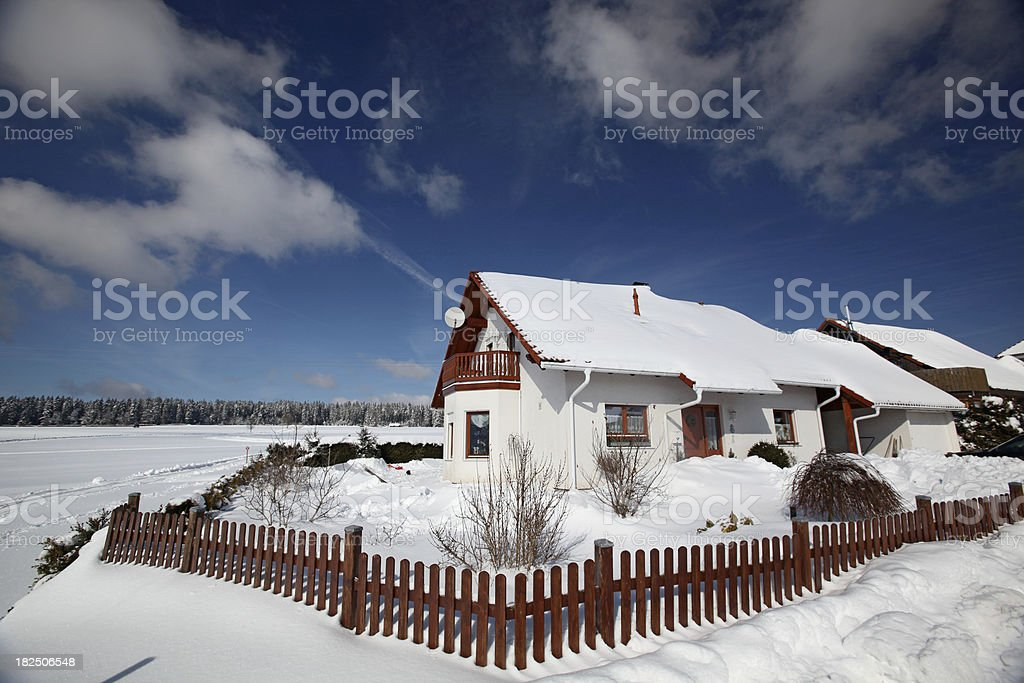 German house in winter landscape and blue sky royalty-free stock photo