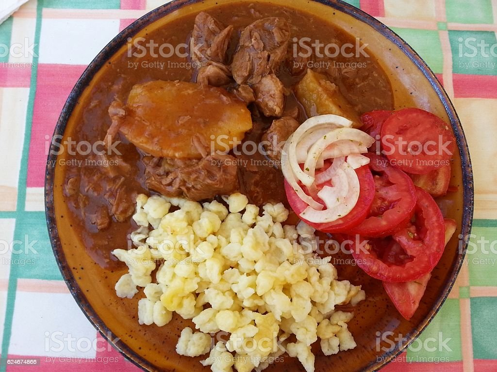 German house meal, gulasch and noodle stock photo