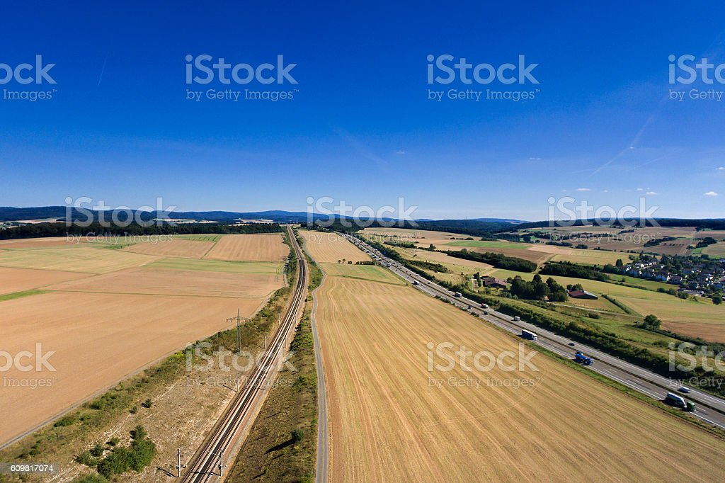 German landscape, railroad tracks and highway stock photo