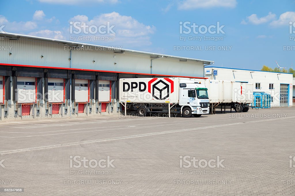 german mercedes benz truck from dpd stands on logistic depot stock photo