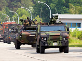 german military army convoy, drives on a street