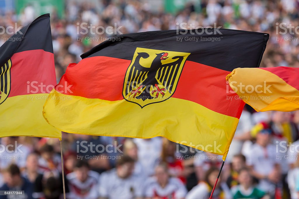 German national flag in front of spectators stock photo