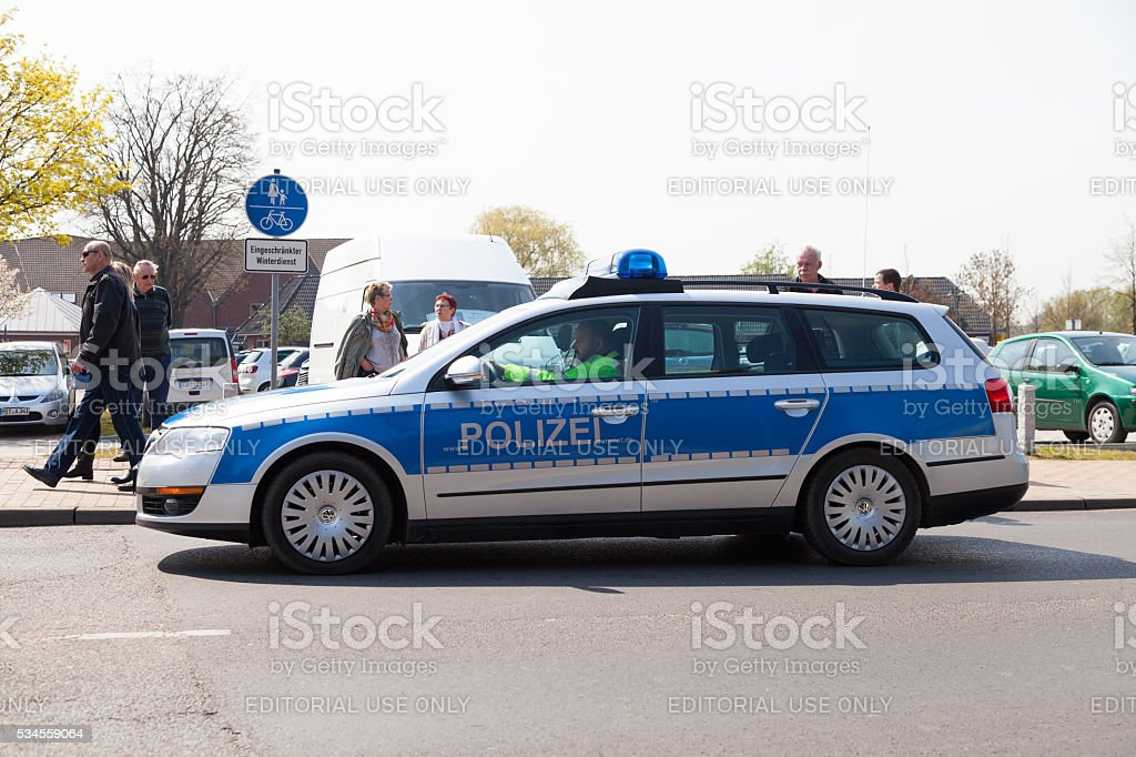 german police car drives on a street stock photo