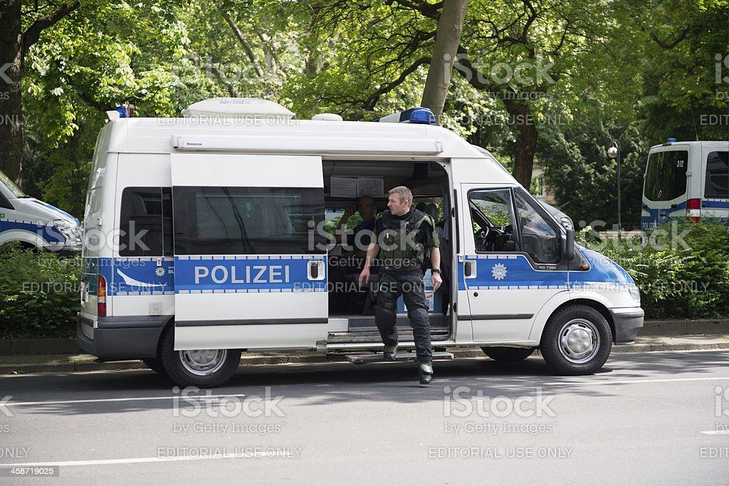 German police officer exitin squad car during Frankfurt Blockupy prostests stock photo