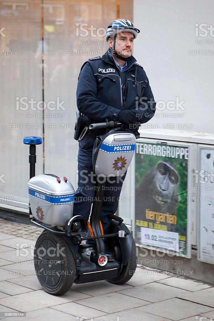 German police officer patrolling on a segway stock photo