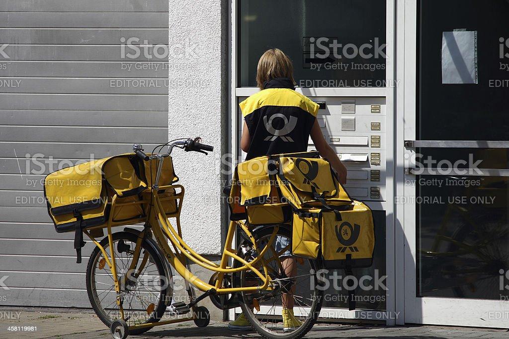 German Postwoman stock photo