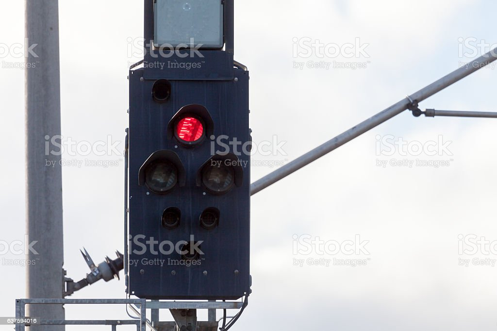 german rail road sign with a red light stock photo