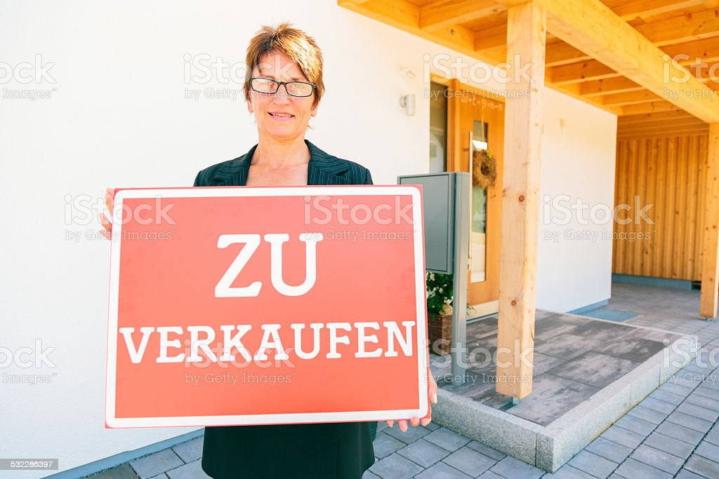 german realtor selling a house stock photo