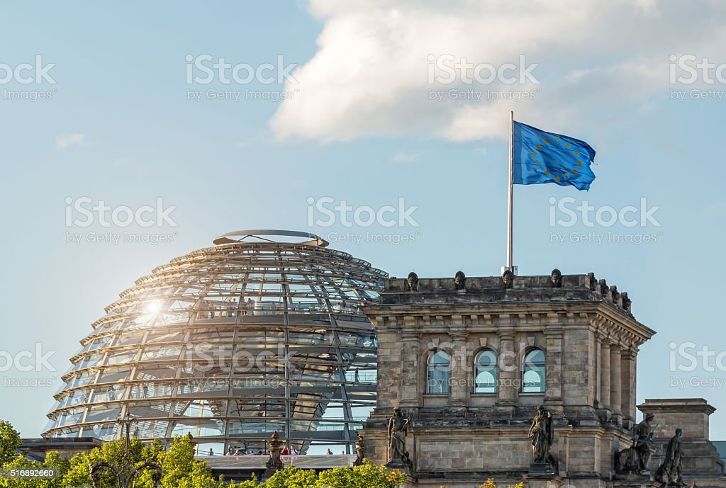 German Reichstag in Berlin with Europe flag stock photo