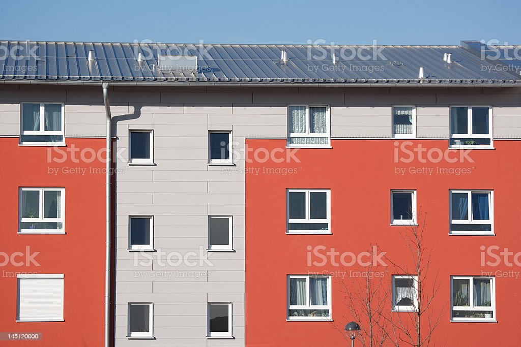 german residential building with red and gray facade royalty-free stock photo