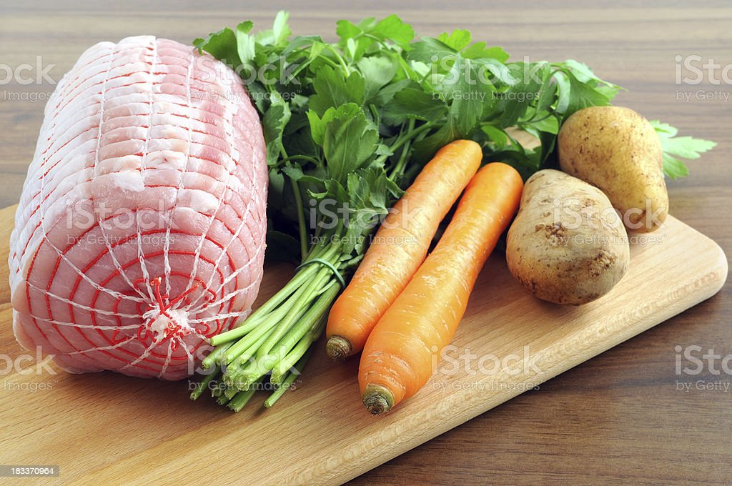 German rollbraten - pork roll bottom round carrot parsley potatoes stock photo