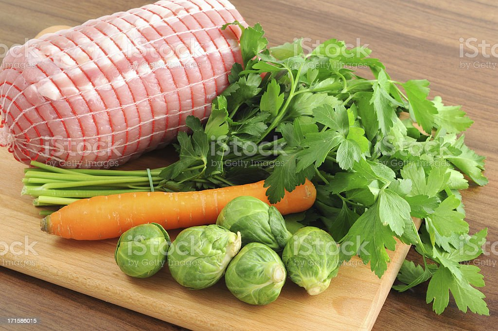 German rollbraten - stuffed and rolled pork loin carrot parsley stock photo