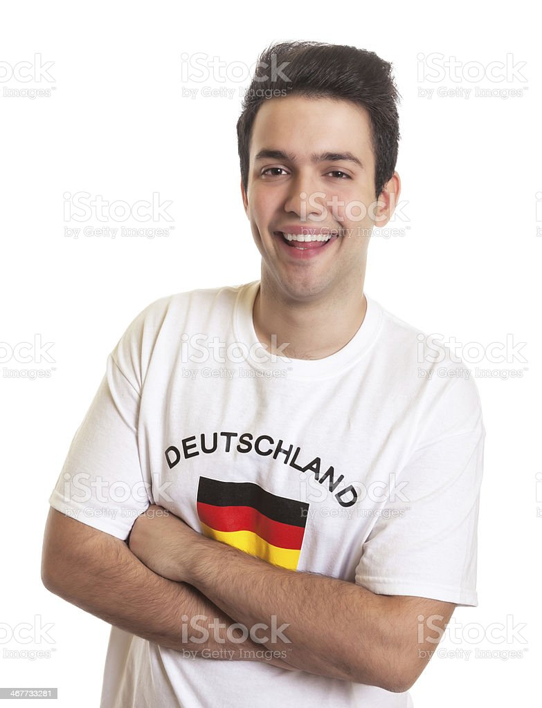German sports fan with black hair laughing at camera stock photo