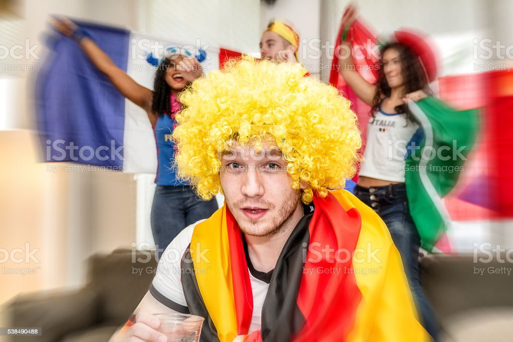 German supporter holding glass of beer stock photo