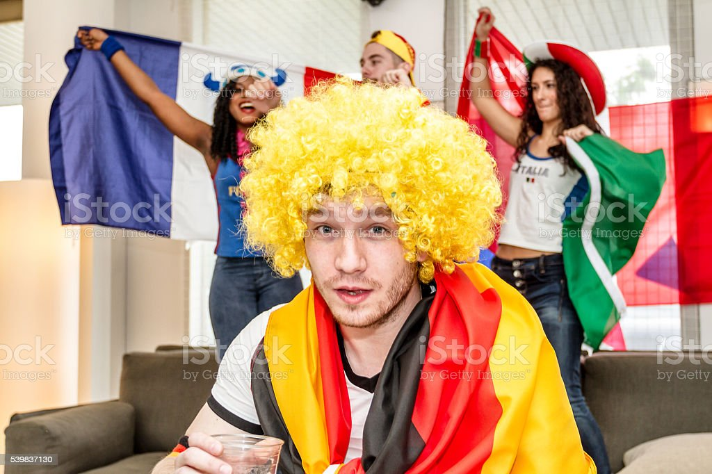 German supporter rejoices holding glass of beer stock photo