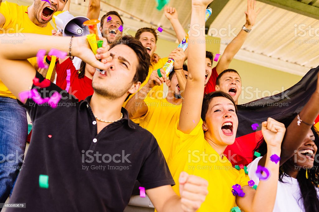 german supporters at stadium enjoying the winning stock photo