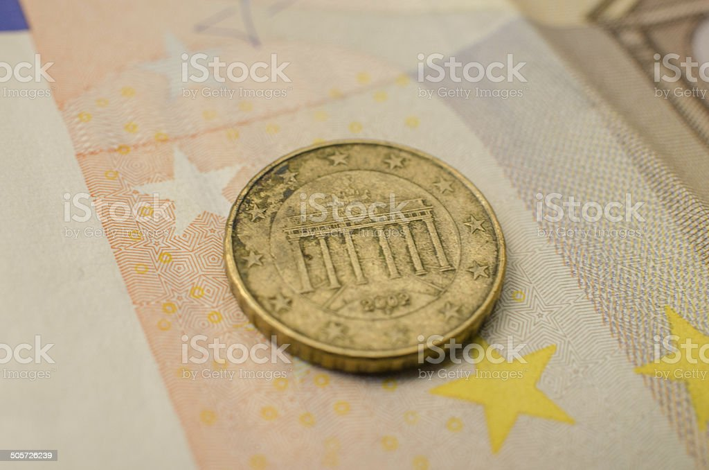 German Ten Euro Cent Coin on a Fifty Banknote stock photo