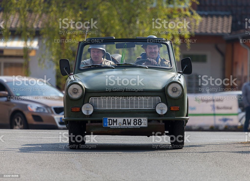 german trabant car drives on a street at oldtimer show stock photo