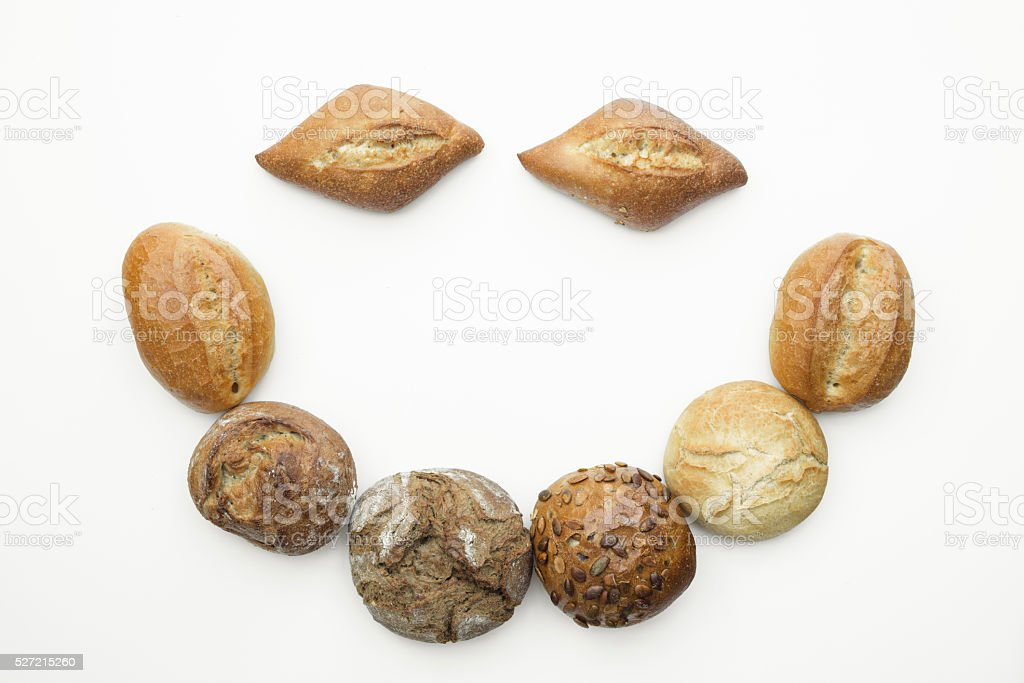 German traditional breads forming a smiley face on white isolate stock photo