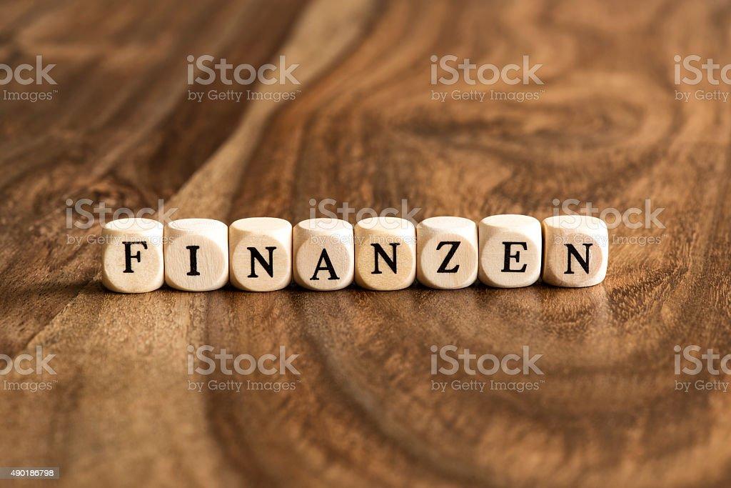 German word FINANZEN on wooden cubes stock photo