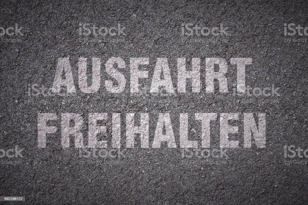 germans word for keep clear - road lettering stock photo