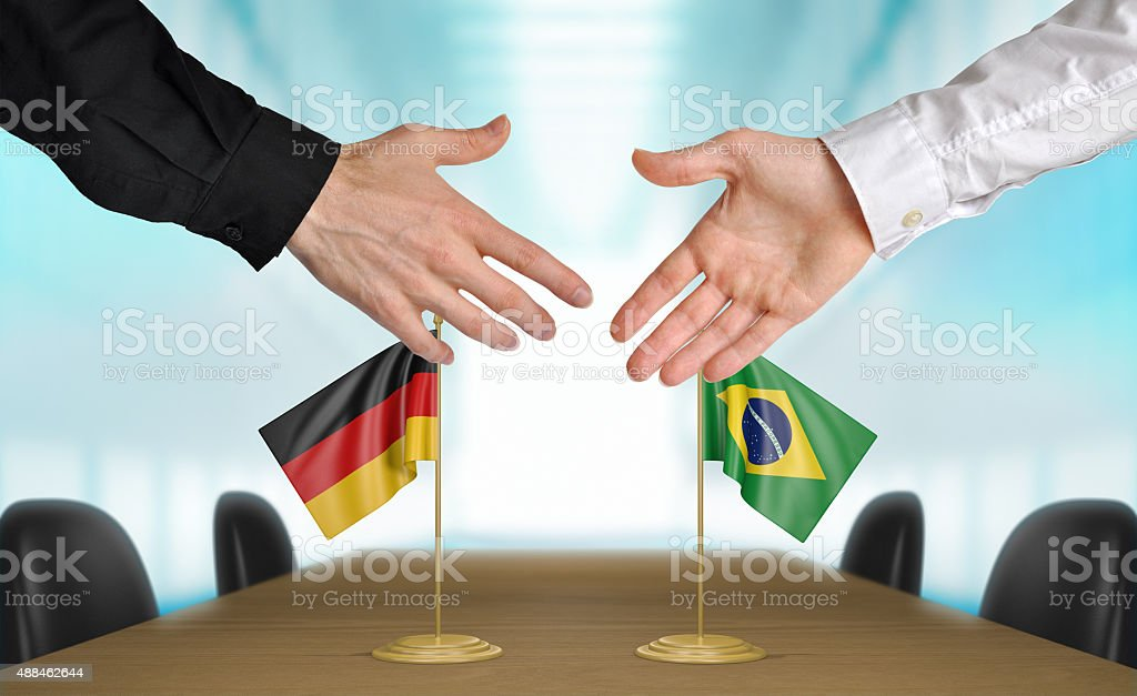Germany and Brazil diplomats agreeing on a deal stock photo