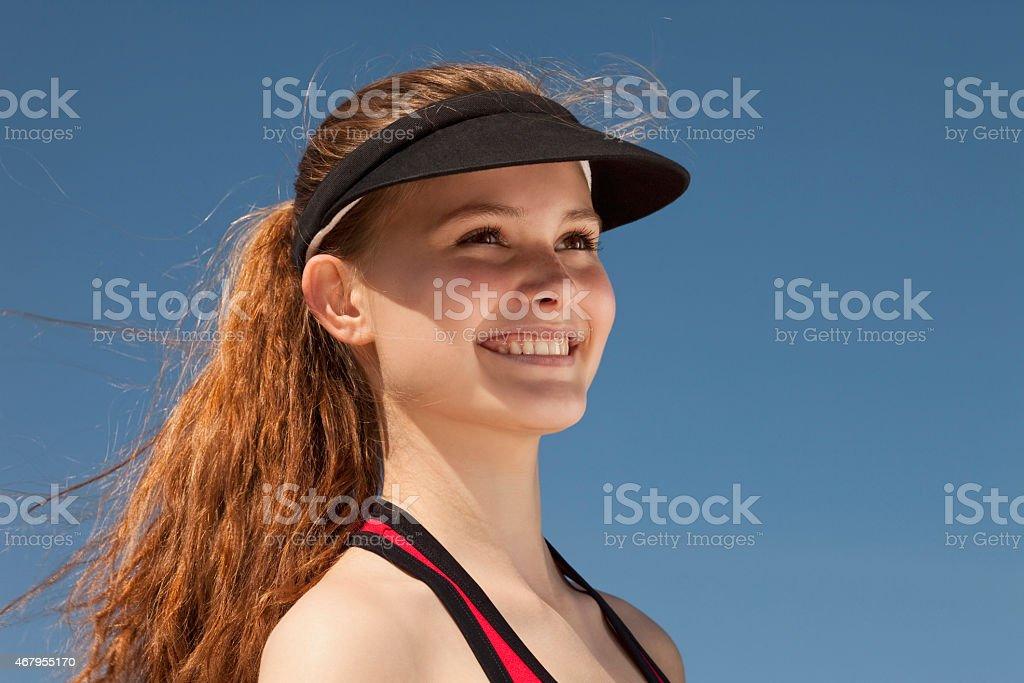 Germany, Bavaria, Teenage girl looking away, smiling stock photo