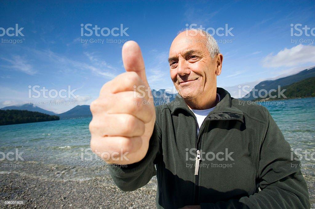 Germany, Bavaria, Walchensee, senior man showing thumbs up sign stock photo