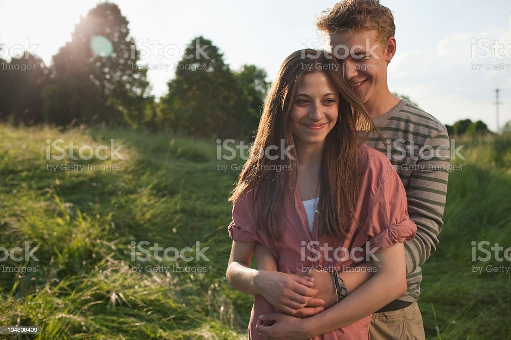 Germany, Berlin, Teenage couple smiling royalty-free stock photo
