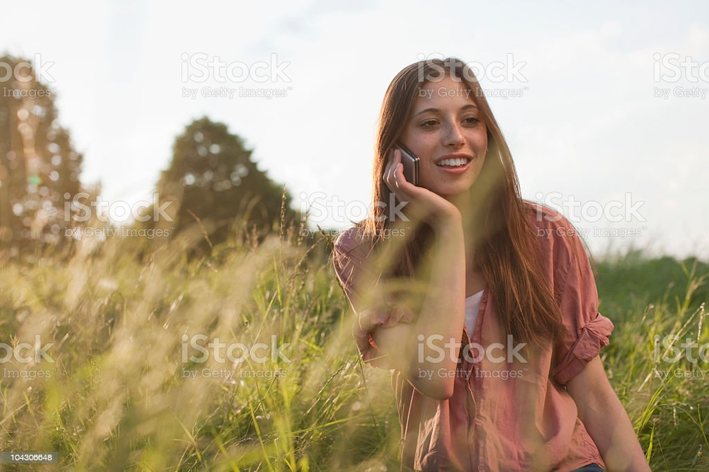 Germany, Berlin, Teenage girl using mobile phone royalty-free stock photo