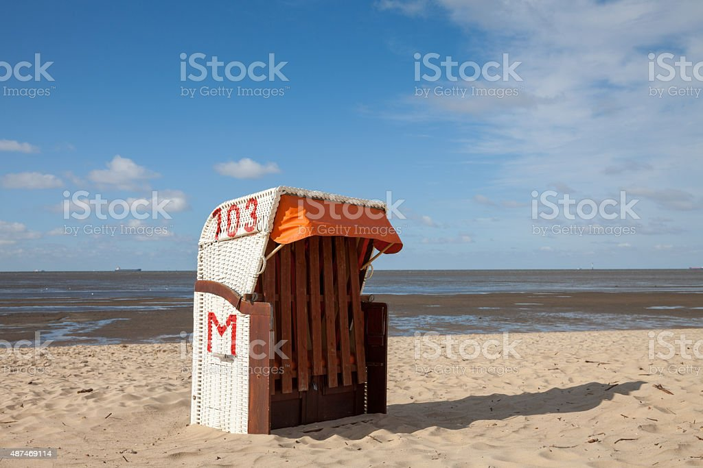 Germany, Cuxhaven, beach and hooded beach chair stock photo