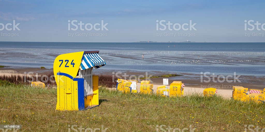 Germany, Cuxhaven, dyke and beach, hooded beach chair stock photo